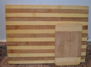 A couple of wooden cutting boards, used but still attractive